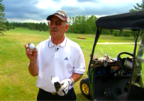 Marathon golfer John Furin displaying a ball Taylor Made had specially made for him